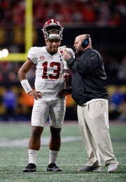 "Tua Tagovailoa of the Alabama Crimson Tide speaks to Brian Daboll, the offensive coordinator, on the sidelines of the 2017 season NCAA national title game. Daboll, now the Buffalo Bills offensive coordinator, said of Tagovailoa, a Heisman Trophy finalist: ""I'm a big fan of Tua and I hope he gets it.''"