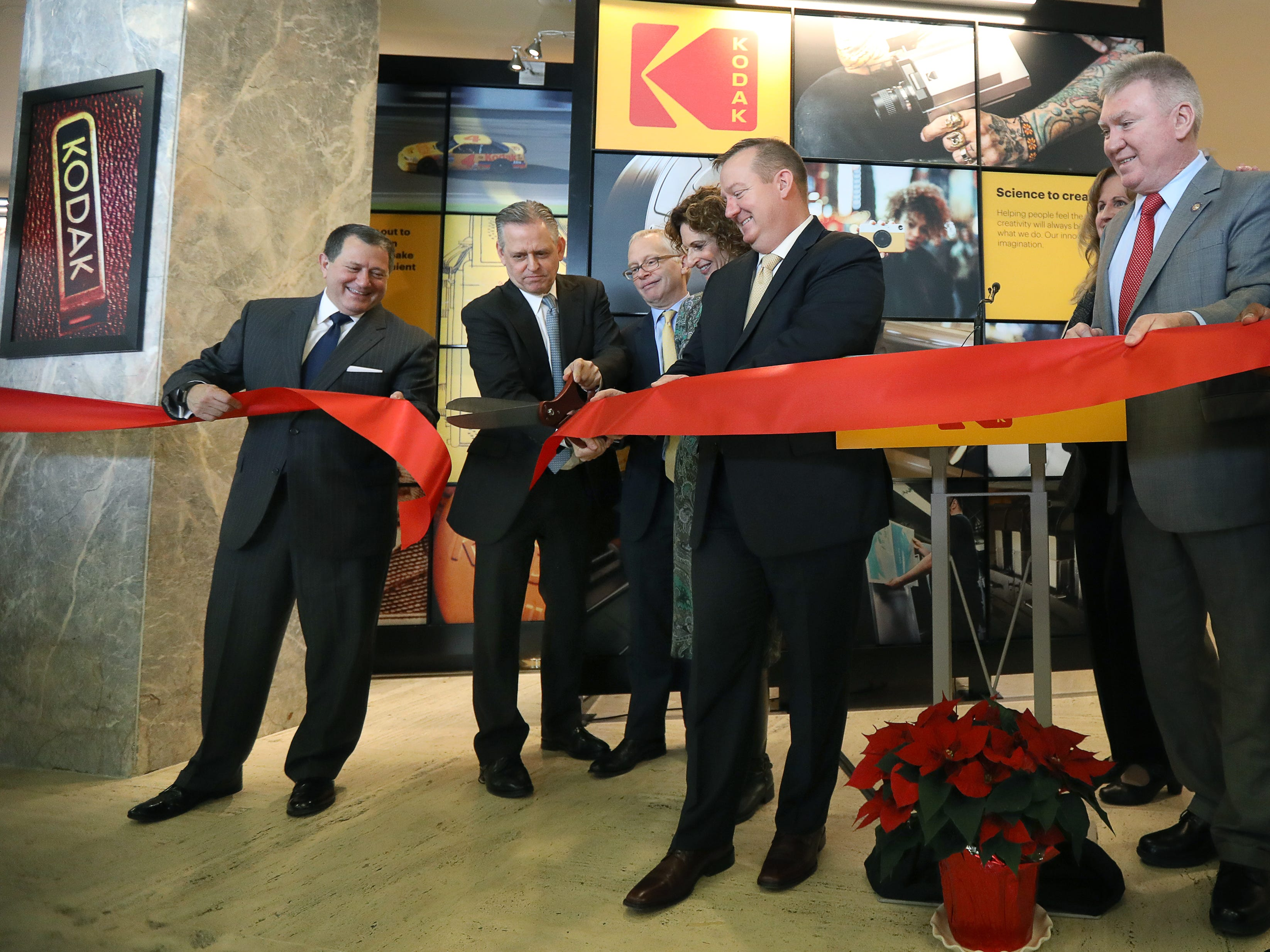 Ribbon cutting with CEO of Kodak Jeff Clarke holding the scissors during the Kodak Visitor Center Grand Opening.