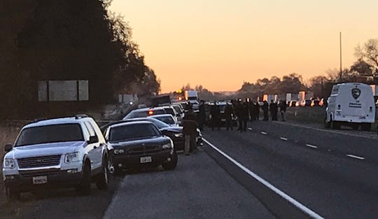 Law enforcement officials were out in full force Thursday at the site of an officer-involved shooting off I-5 south of Redding.