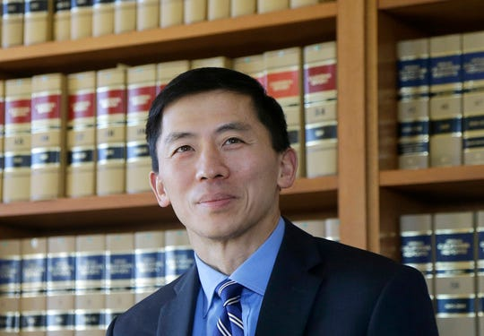 FILE - This Jan. 13, 2017 file photo shows California Supreme Court Associate Justice Goodwin Liu in his office in San Francisco. California Supreme Court justices on Wednesday, Dec. 5, 2018, peppered an attorney representing state workers with tough questions in a closely watched lawsuit over a change to public employee pensions that has the potential to upend California's long-held rule that retirement benefits can never be taken away once promised. (AP Photo/Jeff Chiu, File)