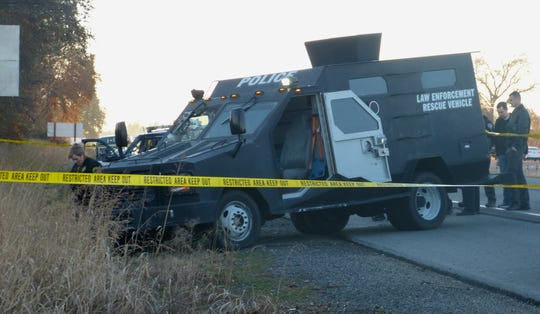 An armored vehicle was one of numerous law enforcement vehicles on scene Thursday at the site of an officer-involved shooting.