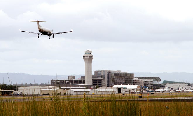 A plane lands at Portland International Airport in Portland, Ore.