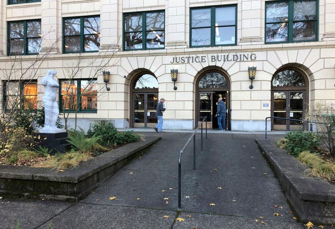 The Oregon Justice Building that houses the state appeals court is seen in Salem, Ore., on Wednesday, Dec. 5, 2018. After losing an appeal in the court late Tuesday, leaders in the Oregon Legislature said Wednesday they'll obey a judge's order to turn over documents to the state's labor commissioner who is investigating sexual harassment at the Capitol.