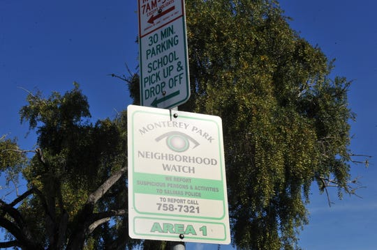 Signs for Monterey Park Elementary School's pick-up and drop-off zones, as well as the area's neighborhood watch, just across the street from the daycare center where a man is accused of sexually abusing children.