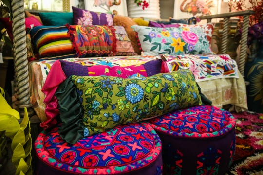 Colorful pillows are displayed at If Walls Could Talk in downtown San Angelo.