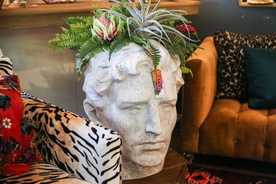 A decor bust with succulents is featured at If Walls Could Talk in downtown San Angelo.