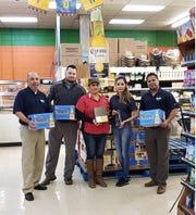 Daniel Castro, Samuel Calhoun and Fernando Reyes present La Azteca employees Rosie Vasquez and Vicky Gonzalez with an award at the store, 2028 N Bryant Blvd., Wednesday, Dec. 5, 2018.
