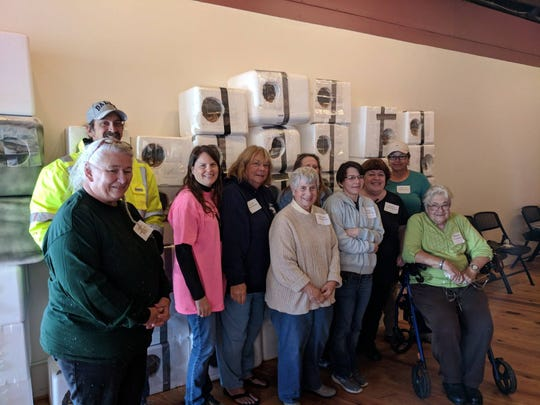Volunteers pose with cat shelters they made during an October event in Chincoteague, Virginia sponsored by CI Community Cats.