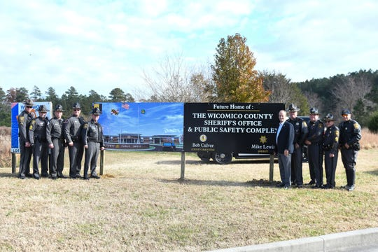 The Wicomico County Sheriff's and Wicomico County Executive Bob Culver stand at the future location of the Wicomico County Sheriff's Office & Public Safety Complex on Westwood Dr.