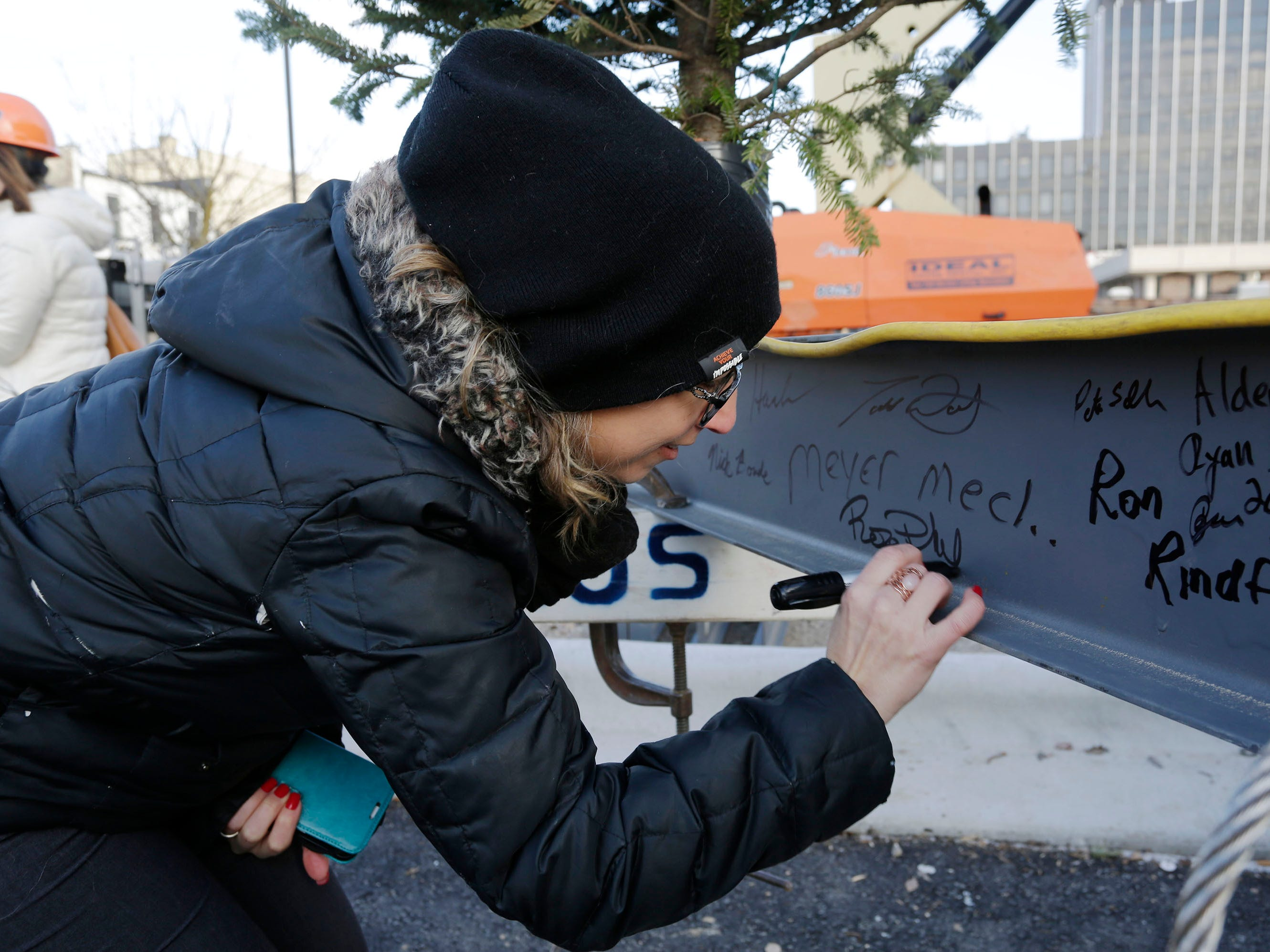 "District 7 Alderperson Rose Phillips signs the last beam for the Sheboygan City Hall renovation project before a topping off ceremony, Wednesday, December 5, 2018, in Sheboygan, Wis. Phillips said, ""It is such a neat opportunity to be part of this history."""