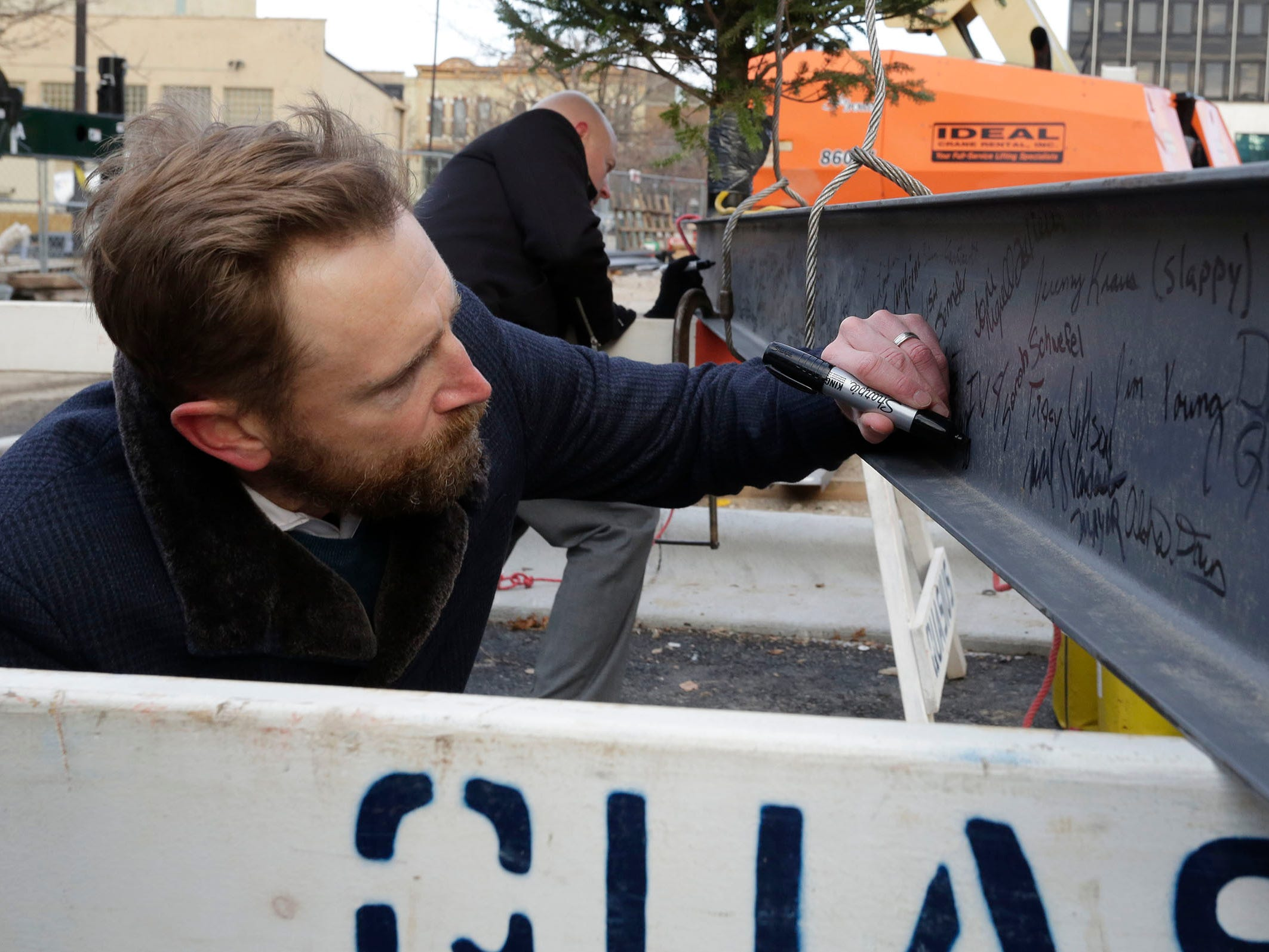 Quasius President Matt Quasius signs the last structural beam at Sheboygan City Hall during a topping off ceremony for the renovation project, Wednesday, December 5, 2018, in Sheboygan, Wis.