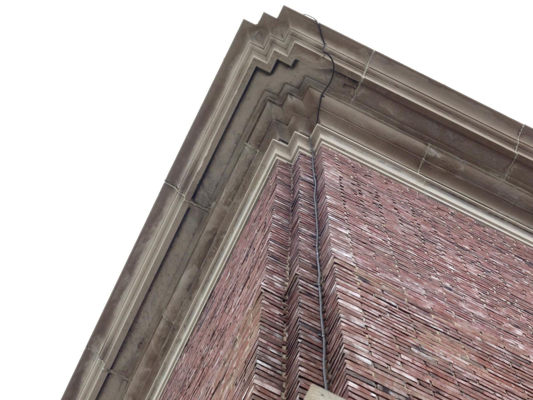 Details of the corners of city hall as seen, Thursday, October 2, 2014, in Sheboygan, Wis. In 1915, building was to cost $74,584. Another $75,000 was used in finally completing it.  Today the 2018 renovations have a budget of 10.5 million dollars.