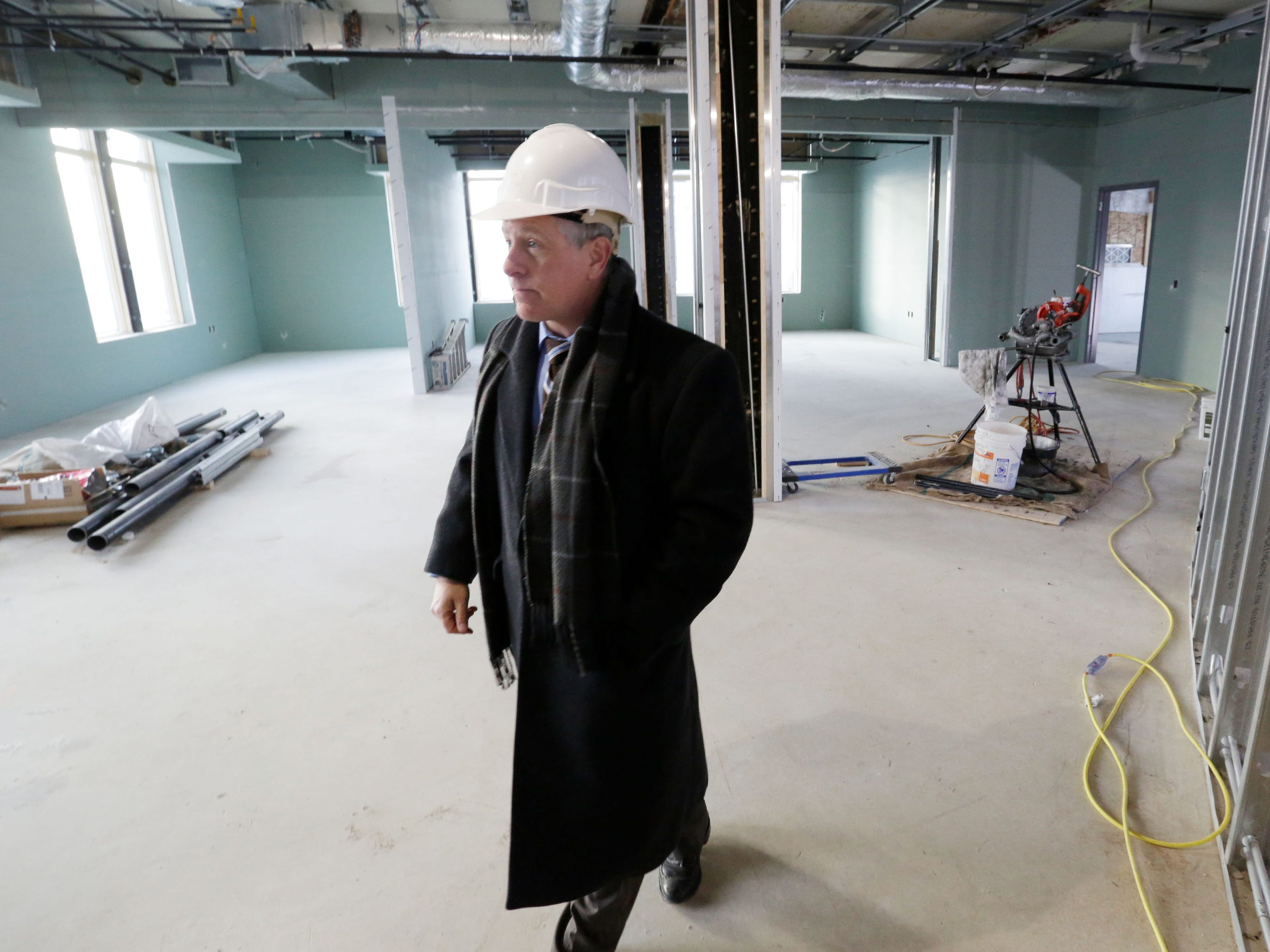 Sheboygan Director of Public Works Dave Biebel walks in a construction area at Sheboygan City Hall, Wednesday, December 5, 2018, in Sheboygan, Wis. The facility is undergoing renovated that is budgeted for 10.5 million dollars.