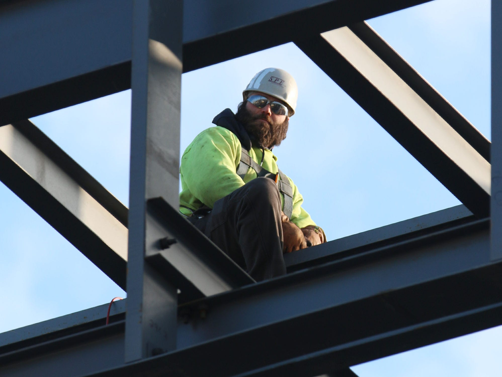 A construction worker is framed by steel at the Sheboygan City Hall renovation project, Wednesday, December 5, 2018, in Sheboygan, Wis.