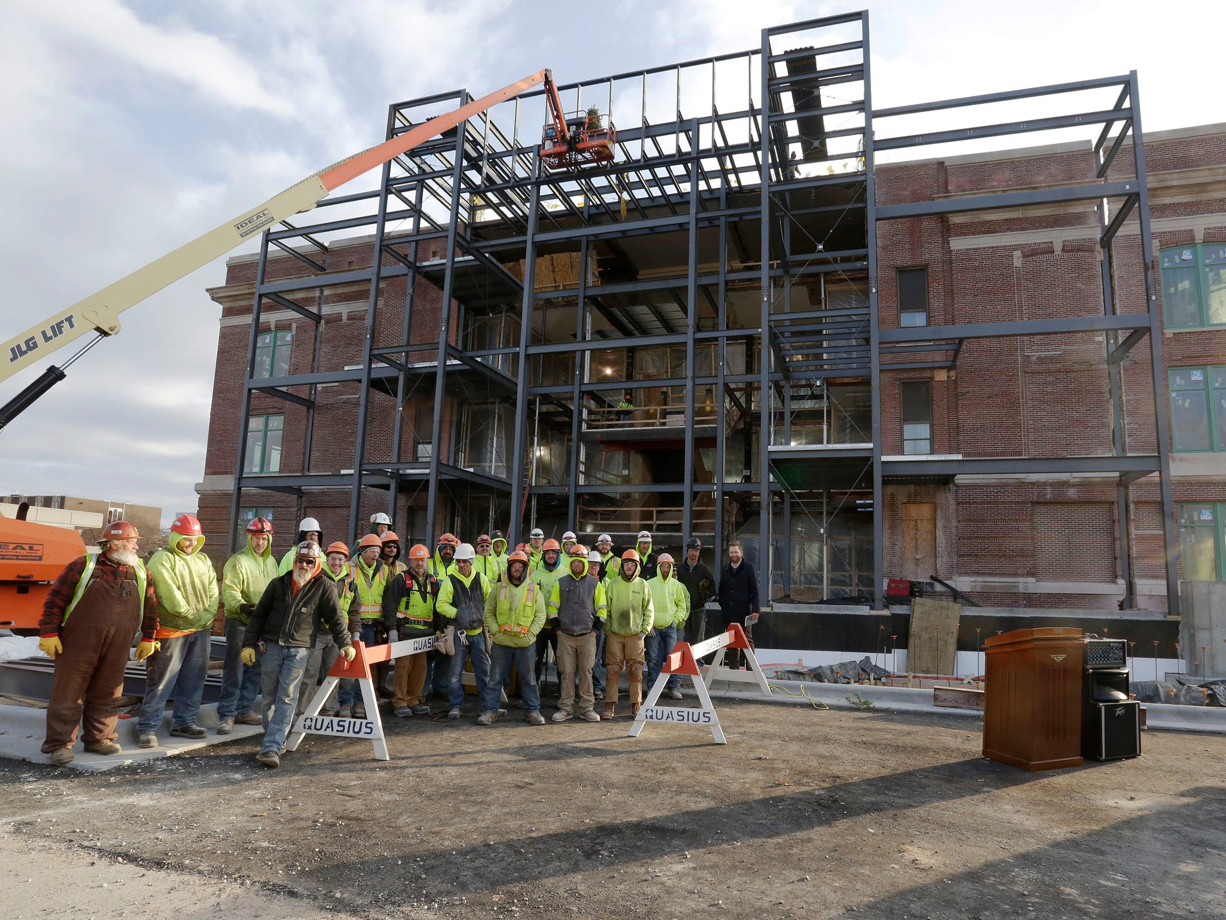 Construction workers working on the Sheboygan City Hall renovation project pose in front of the building, Wednesday, December 5, 2018, in Sheboygan, Wis.