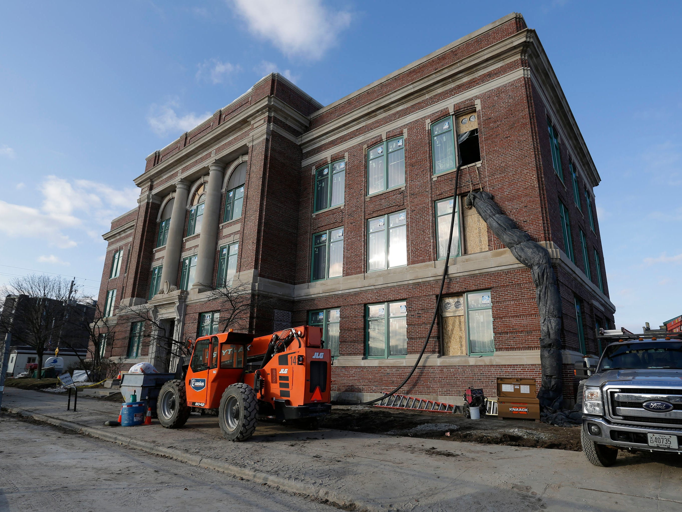 A view of the south part of Sheboygan City Hall, Wednesday, December 5, 2018, in Sheboygan, Wis. The city held a topping off ceremony Wednesday, which marked the last beam installed on the new front facade of the renovated structure.