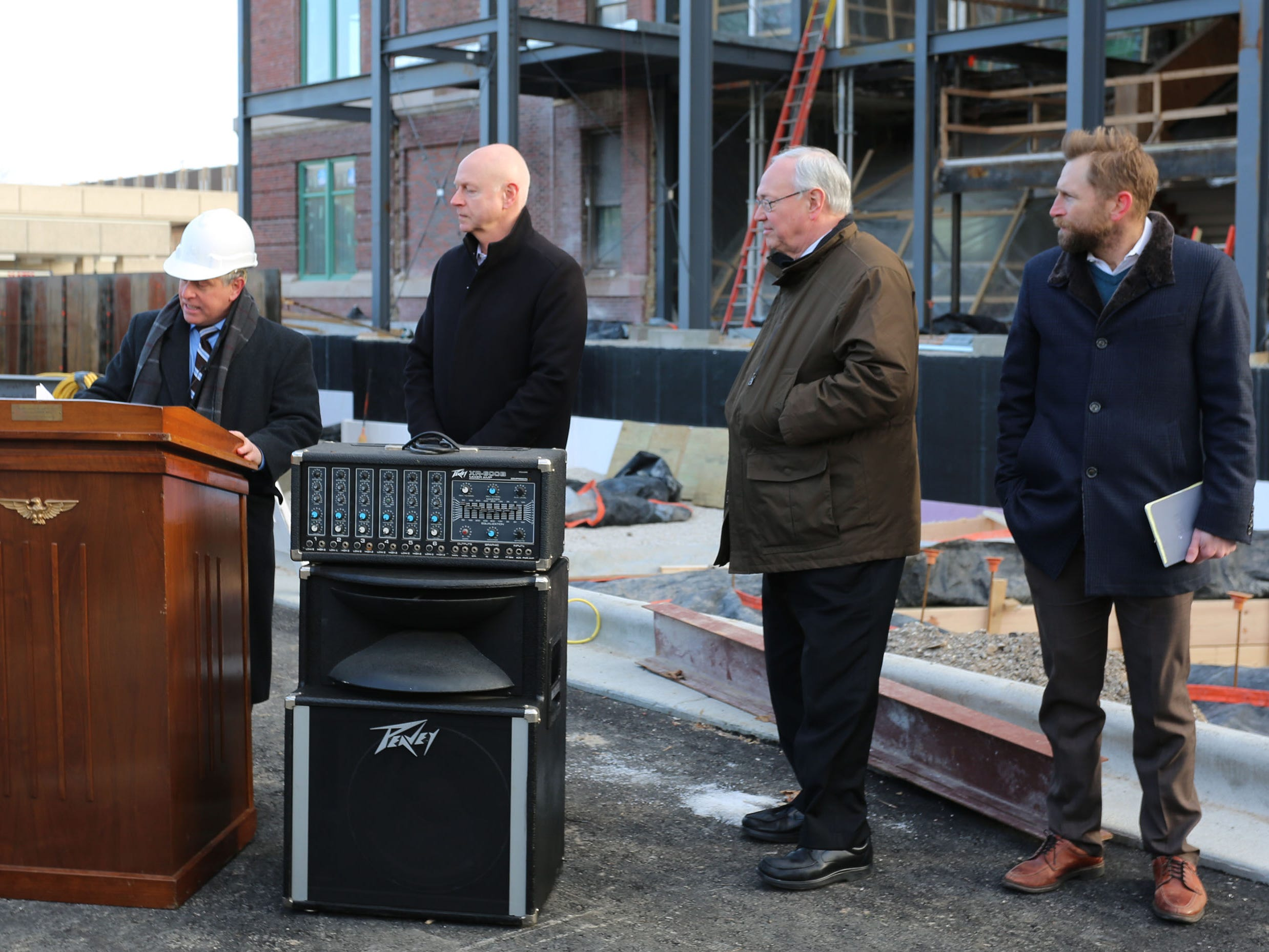 Sheboygan Director of Public Works Dave Biebel, left, speaks at a topping off ceremony for the Sheboygan City Hall 10.5 million dollar renovation project, Wednesday, December 5, 2018, in Sheboygan, Wis. Watching from left are City Administrator Darrell Hoflan, Mayor Michael Vandersteen and Quasius President Matt Quasius.
