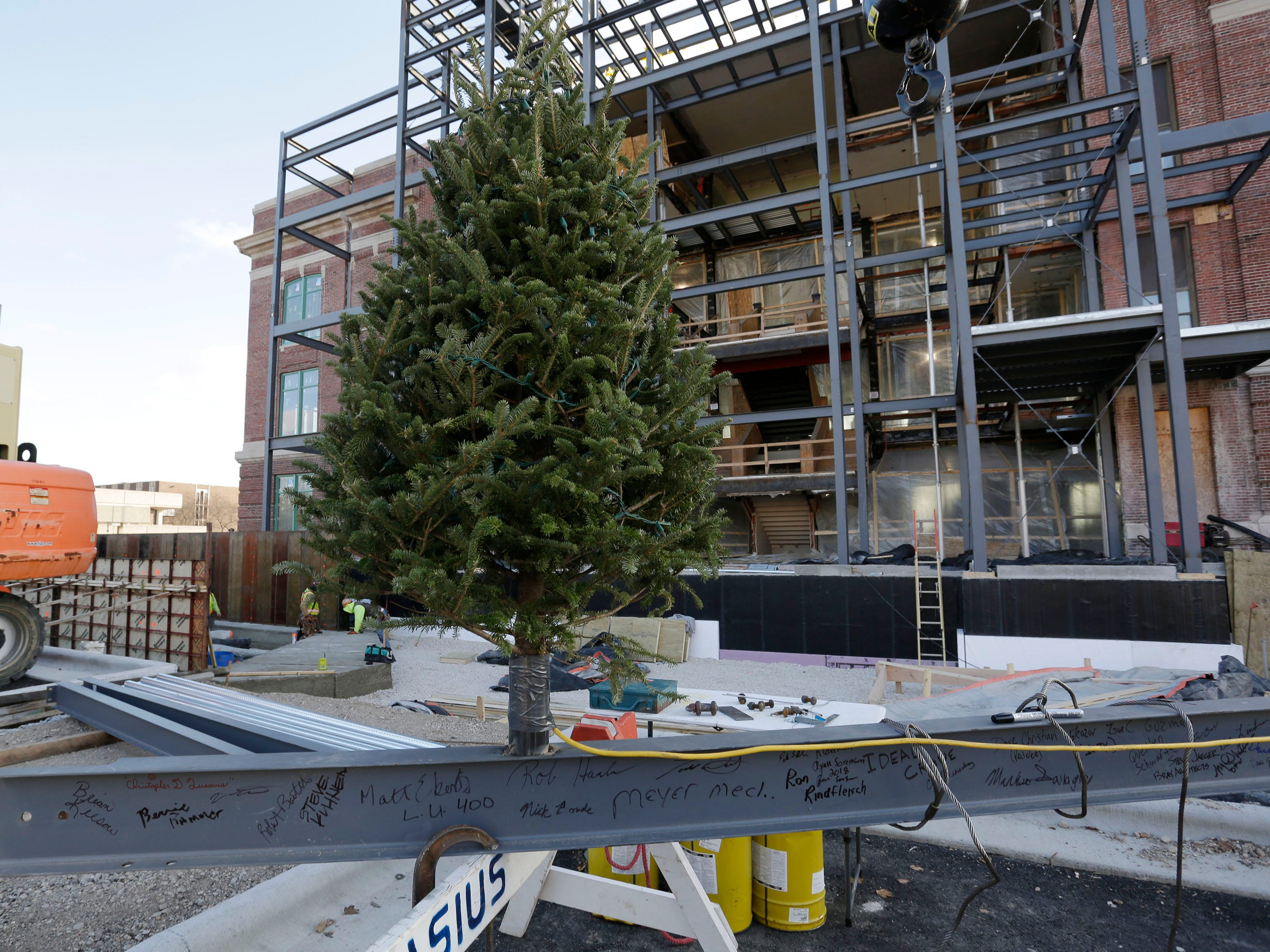 The last structural beam for the Sheboygan City Hall renovation project has a Christmas tree on it before a special topping off ceremony, Wednesday, December 5, 2018, in Sheboygan, Wis.  The city held a topping off ceremony Wednesday, which marked the last beam installed on the new front facade of the renovated structure.