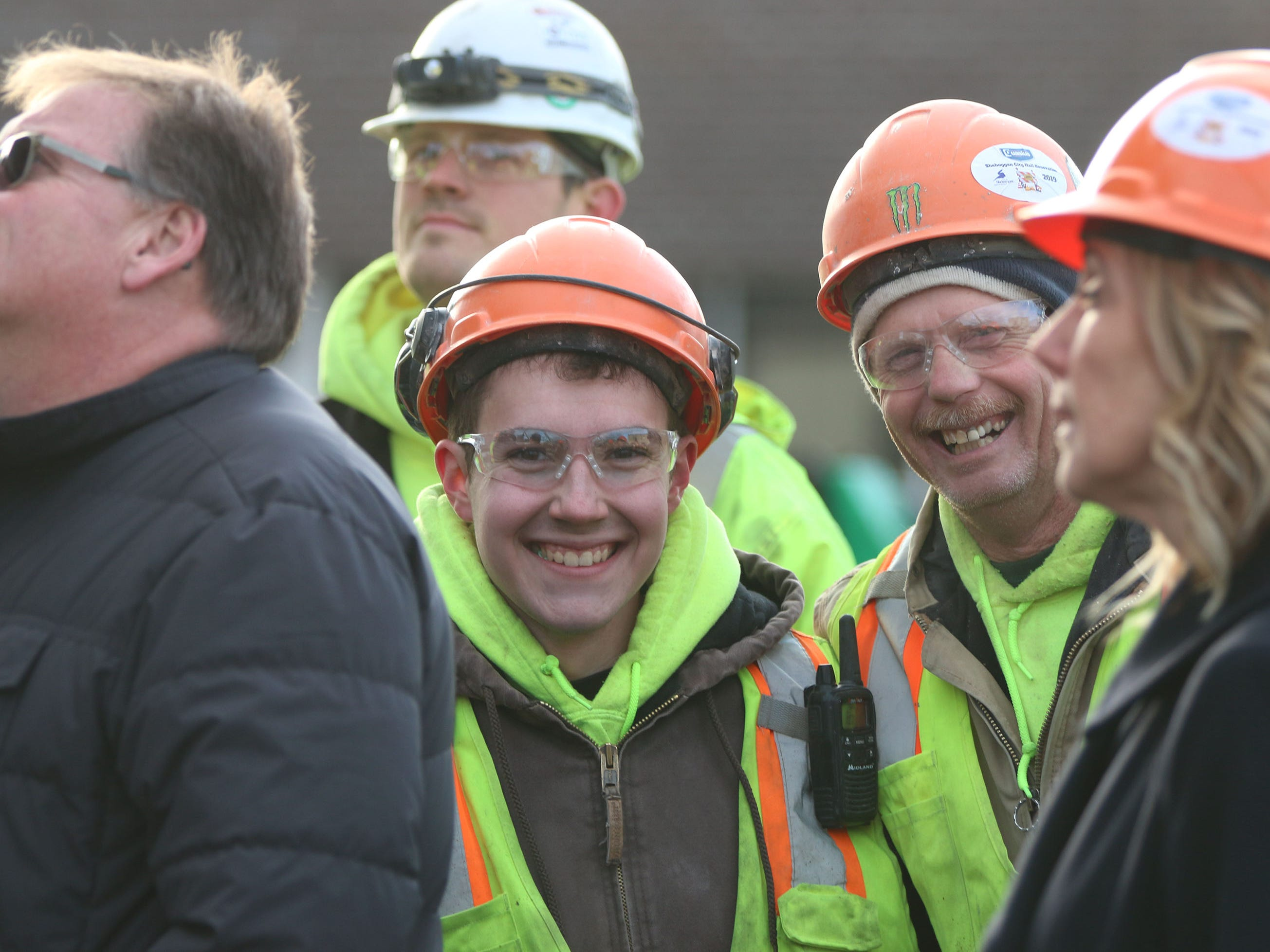 Construction workers smiles during the topping off ceremony for the Sheboygan City Hall renovation project, Wednesday, December 5, 2018, in Sheboygan, Wis.