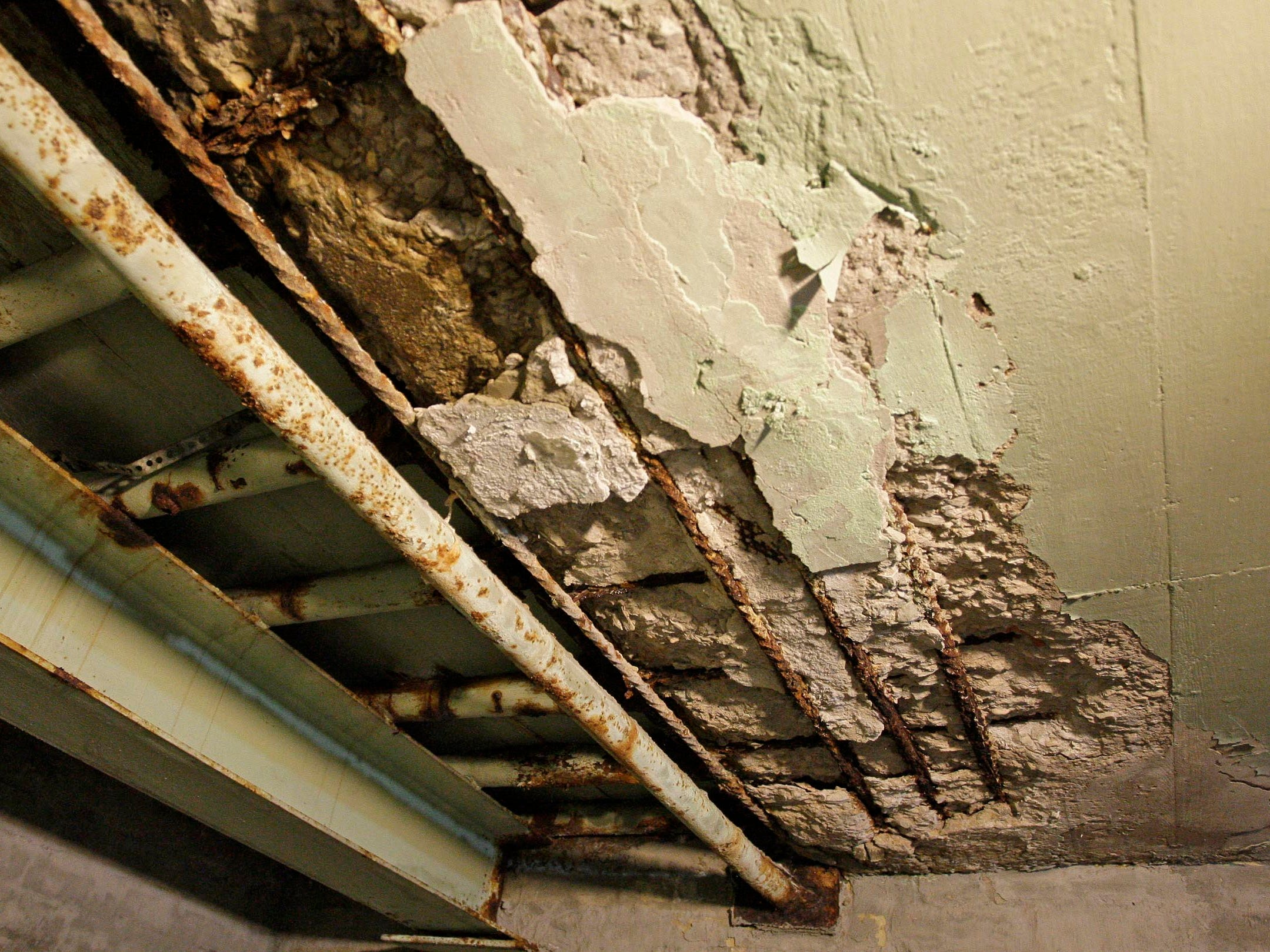 Water damage is evident in the basement area as seen, Thursday October 2, 2014, that is used for storage at Sheboygan City Hall.  The area used to be the coal bin when the city heated the building with coal fired boilers.