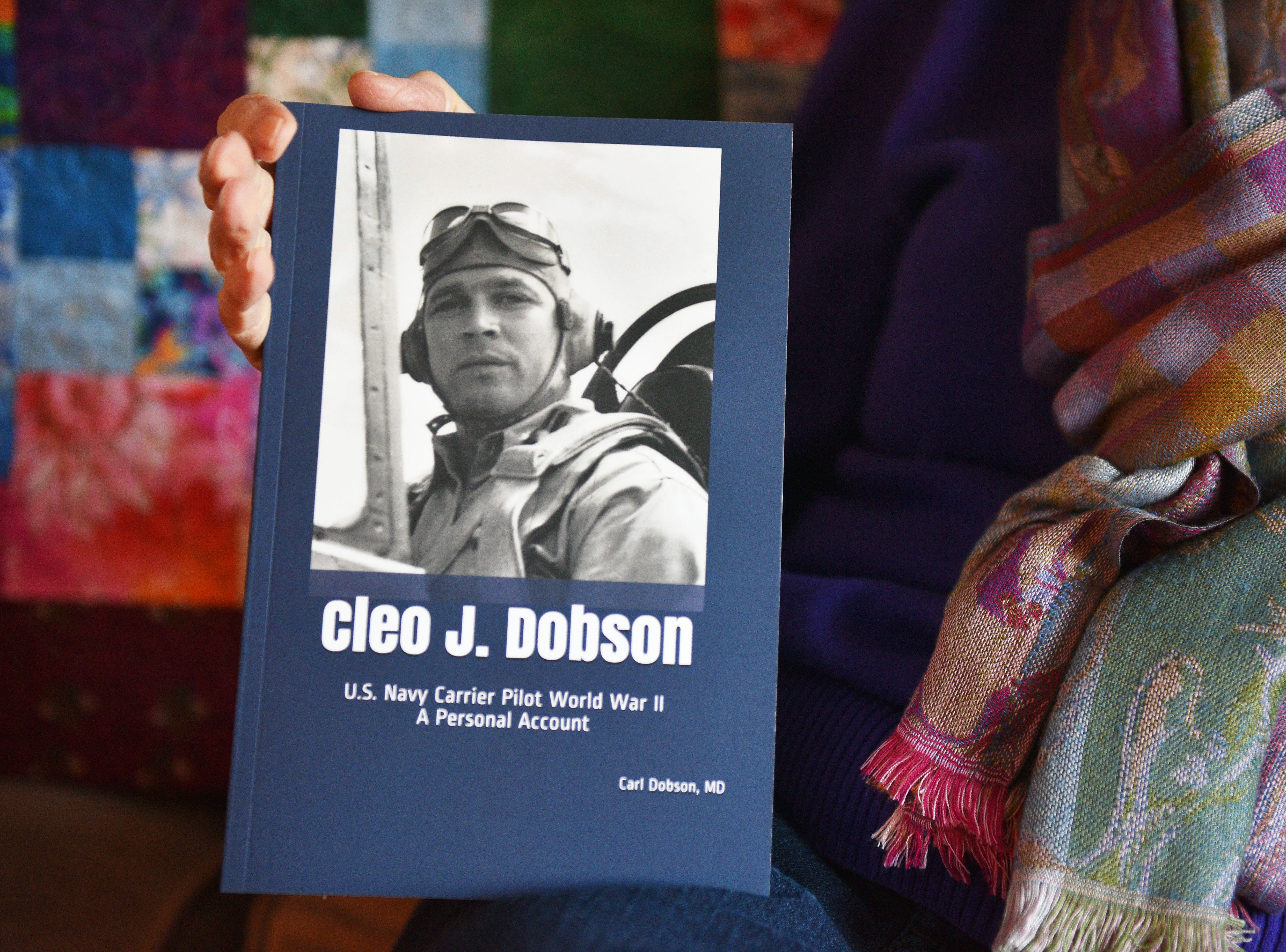 Nancy Napier talks about a book her and her cousin, Carl Dobson, published about her father, Cleo Dobson, Wednesday Dec. 5, in Sioux Falls. Napier's father was a U.S. Navy carrier pilot in World War II. The book is titled  ÒCleo J. Dobson: U.S. Navy Carrier Pilot World War II, a Personal Account.Ó