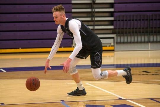 Drew Guebert (23) dribbles the ball, Wednesday, Dec. 5, 2018 at the Stewart Center in Sioux Falls, S.D.
