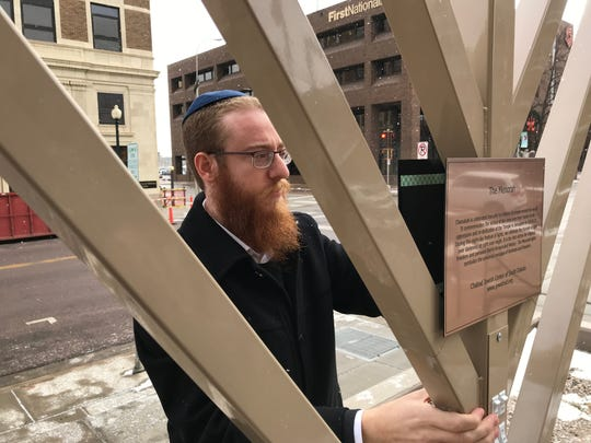 Rabbi Mendel Alperowitz leads a menorah lighting in front of the Wells Fargo building in downtown Sioux Falls.
