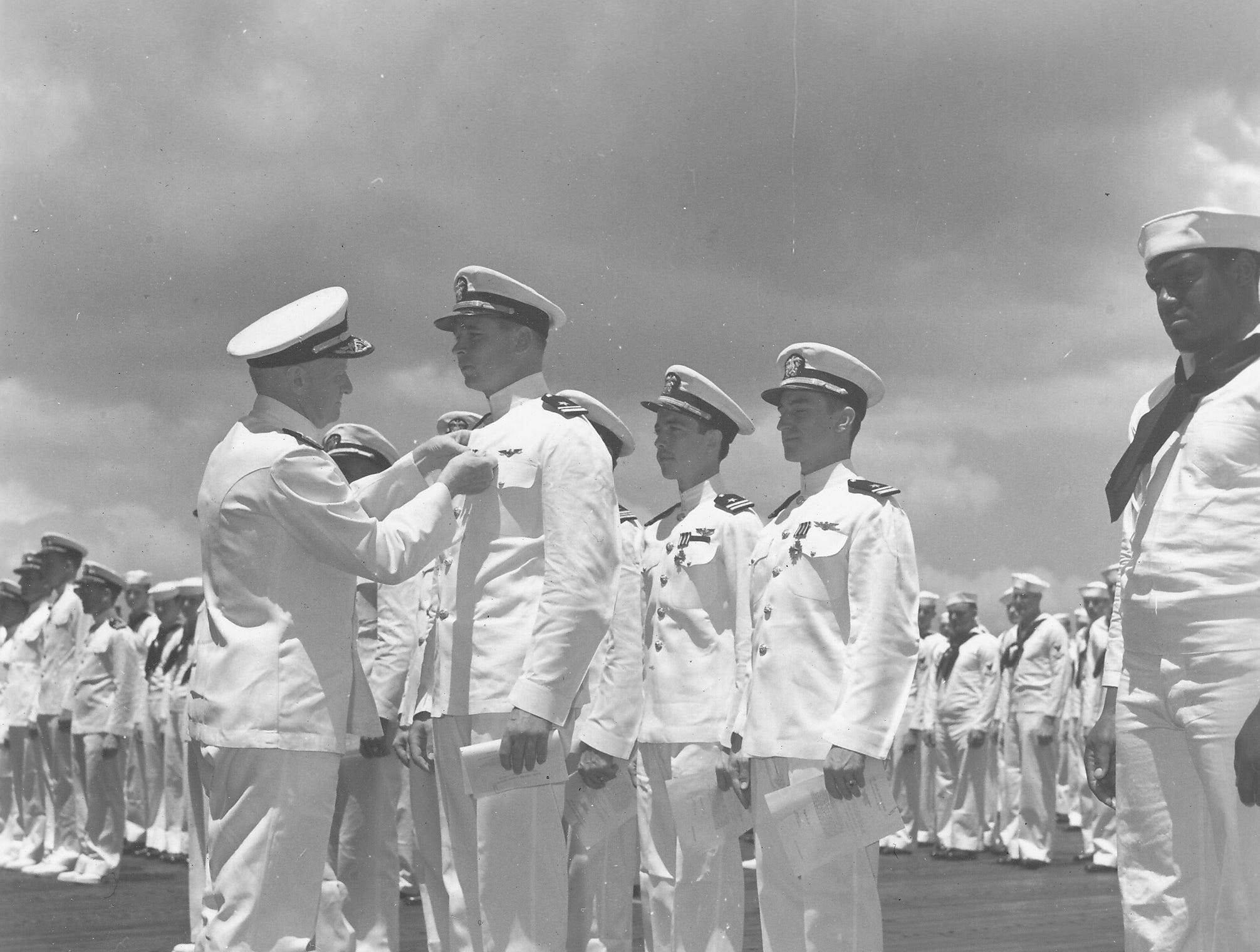 Cleo J. Dobson receiving Distinguished Flying Cross Medal from Admiral Nimitz, May 24, 1942.