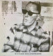 "Maynard ""Red"" Hollandsworth was one of the three bank robbers.  He was sentenced to 16 years in prison in 1966. According to public records, he apparently died in prison four years later at the age of 55."