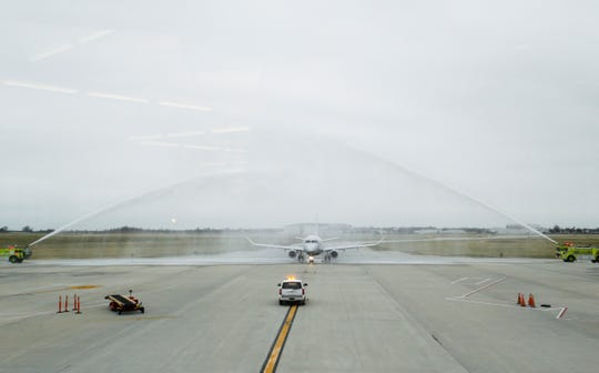 A plane carrying the Springfield-Branson National Airport's 1 millionth passenger this year is sprayed down by water cannons as it taxis to the gate on Thursday, Dec. 6, 2018.