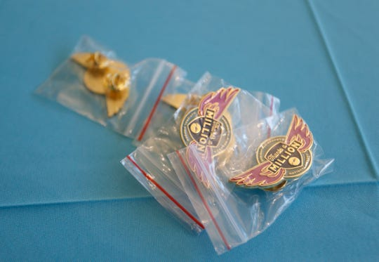 Pins given to passengers aboard the plane carrying the Springfield-Branson National Airport's 1 millionth passenger.