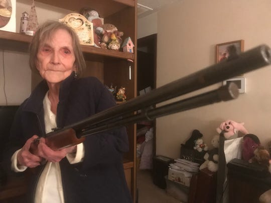 Barbara Wells, now 88, displays the rifle she fired 52 years ago when she thought bank robbers were in her family's chicken house.