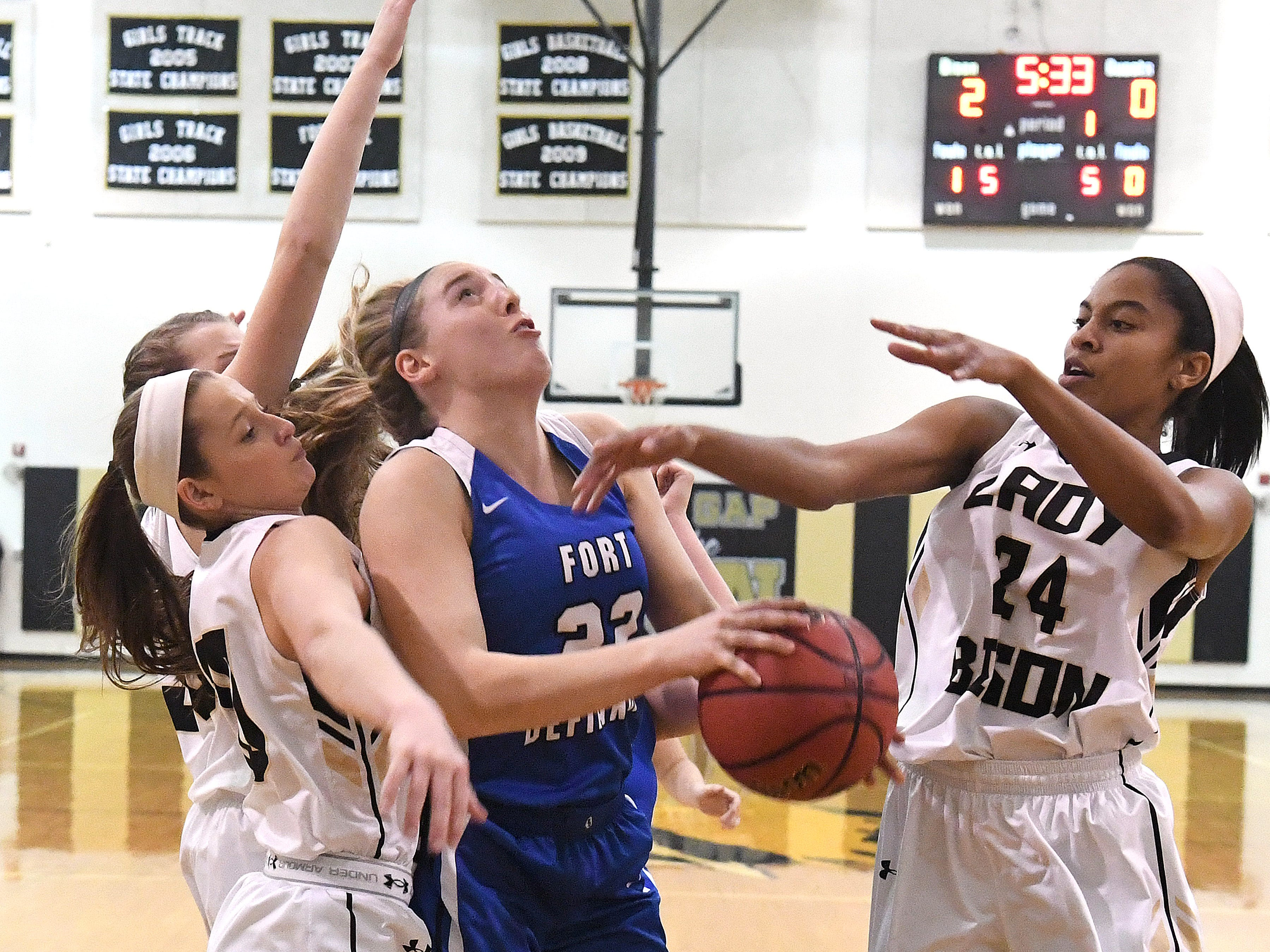 Fort Defiance's Catie Cramer looks to the basket to shoot as Buffalo Gap's Amaya Lucas (#24) guards during a game played in Swoope on Wednesday, Dec. 5, 2018.