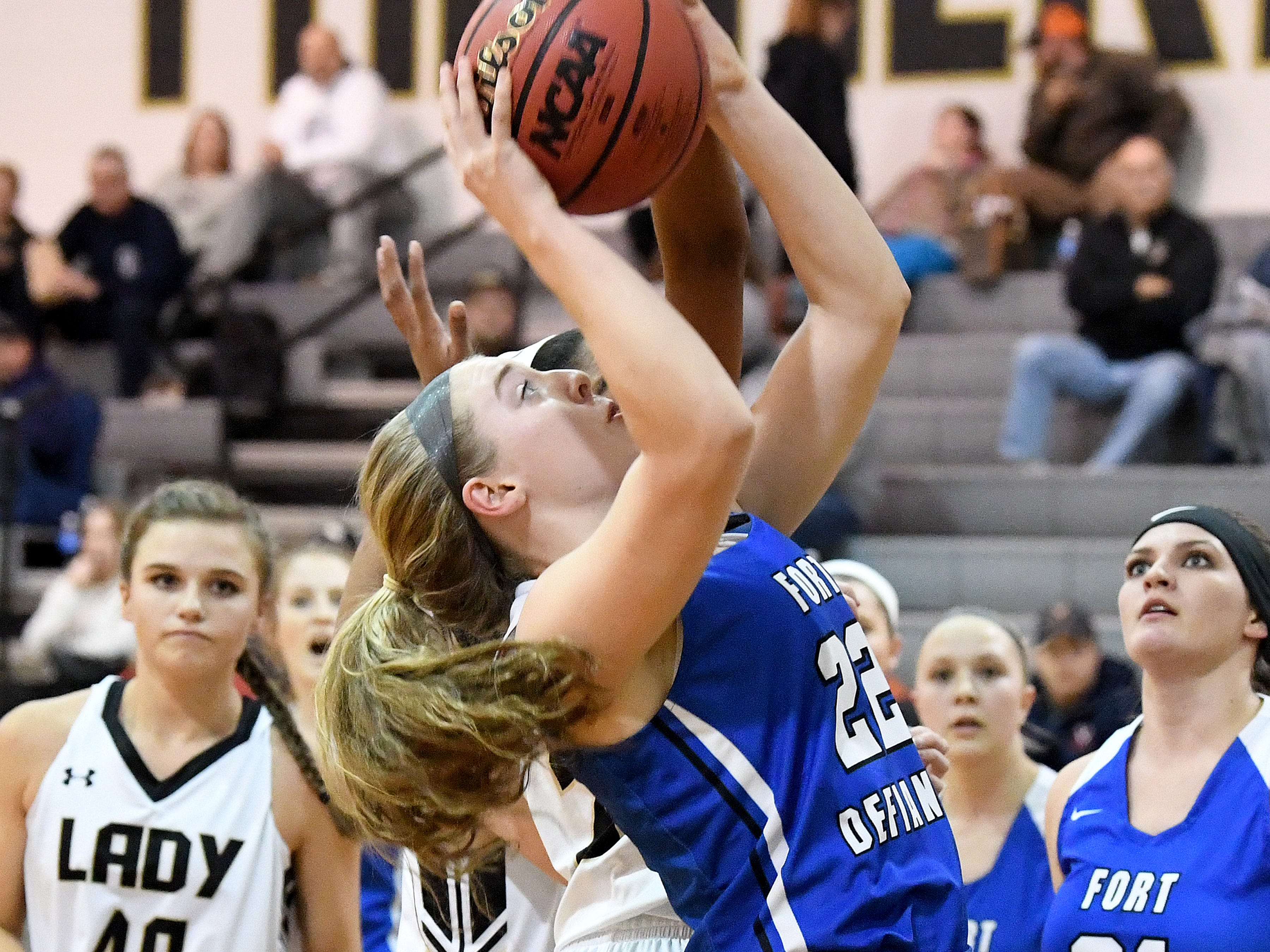 Fort Defiance's Catie Cramer looks to the basket and shoots during a game played in Swoope on Wednesday, Dec. 5, 2018.