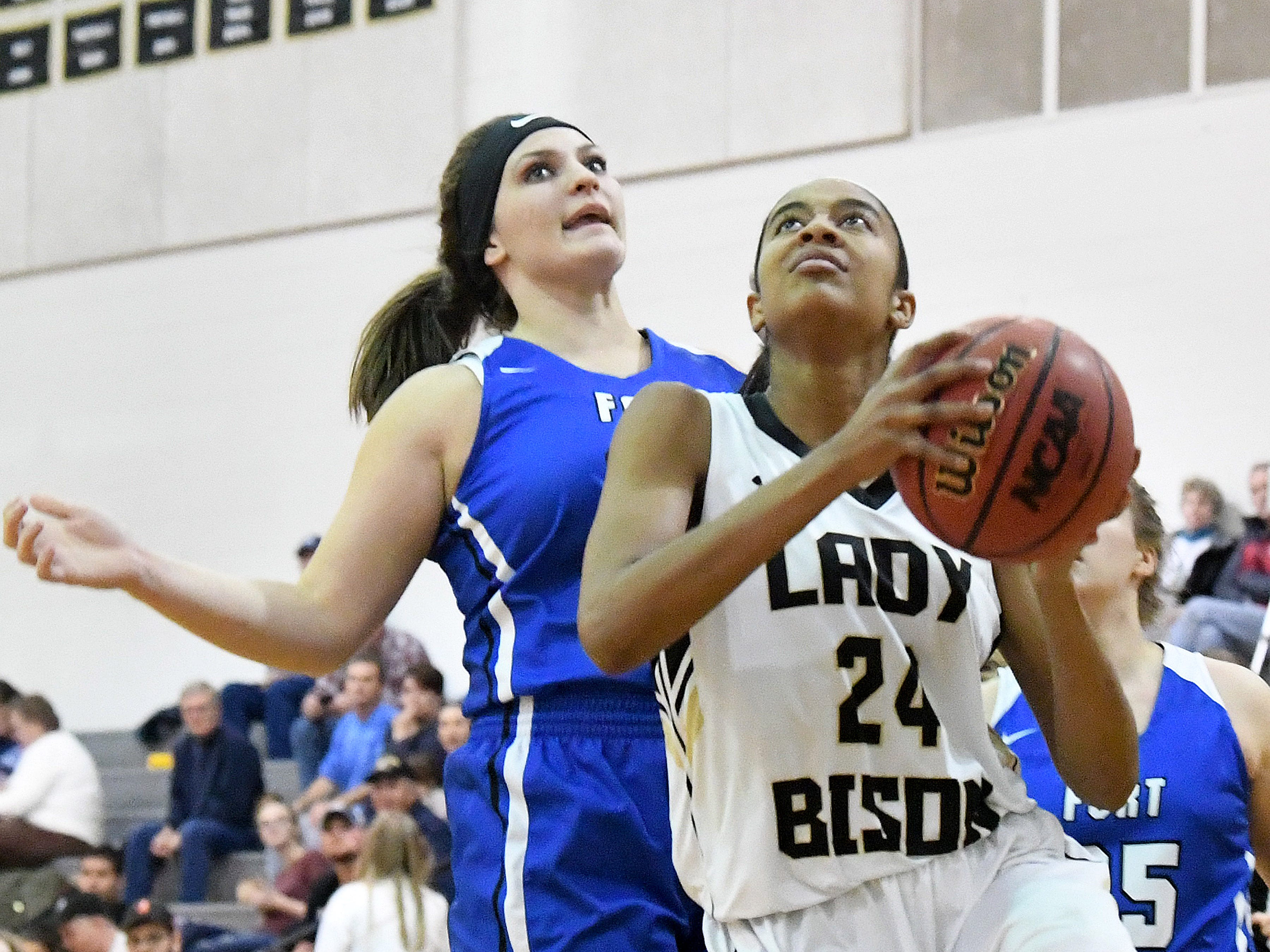 Buffalo Gap's Amaya Lucas looks to the basket to shoot after getting around Fort Defiance's Cailin Wright during a game played in Swoope on Wednesday, Dec. 5, 2018.