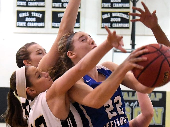 Fort Defiance's Catie Cramer tries to shoot as Buffalo Gap defenders crowd her under the basket during a game played in Swoope on Wednesday, Dec. 5, 2018.