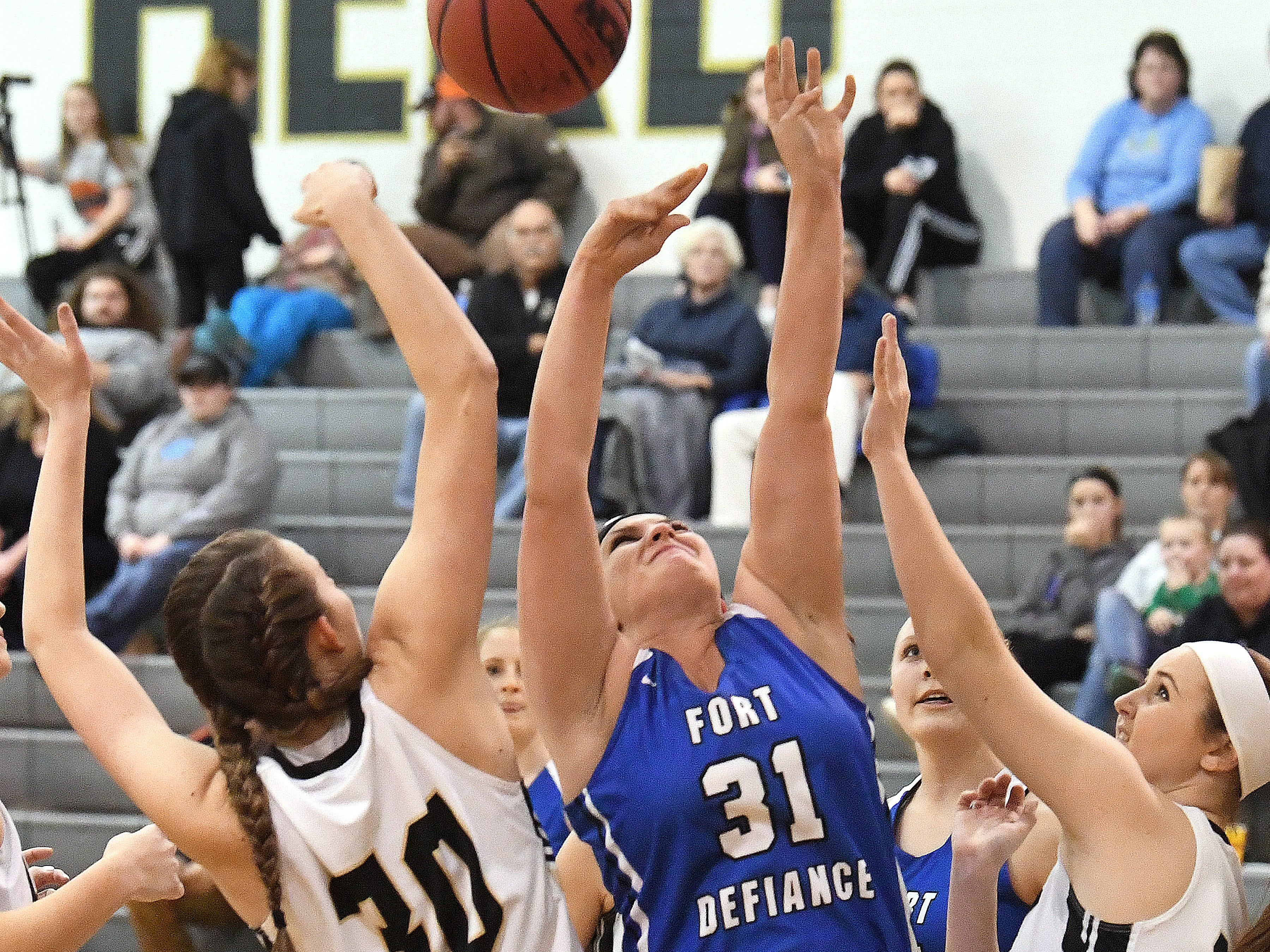 Fort Defiance's Meredith Lloyd (center) shoots during a game played in Swoope on Wednesday, Dec. 5, 2018.