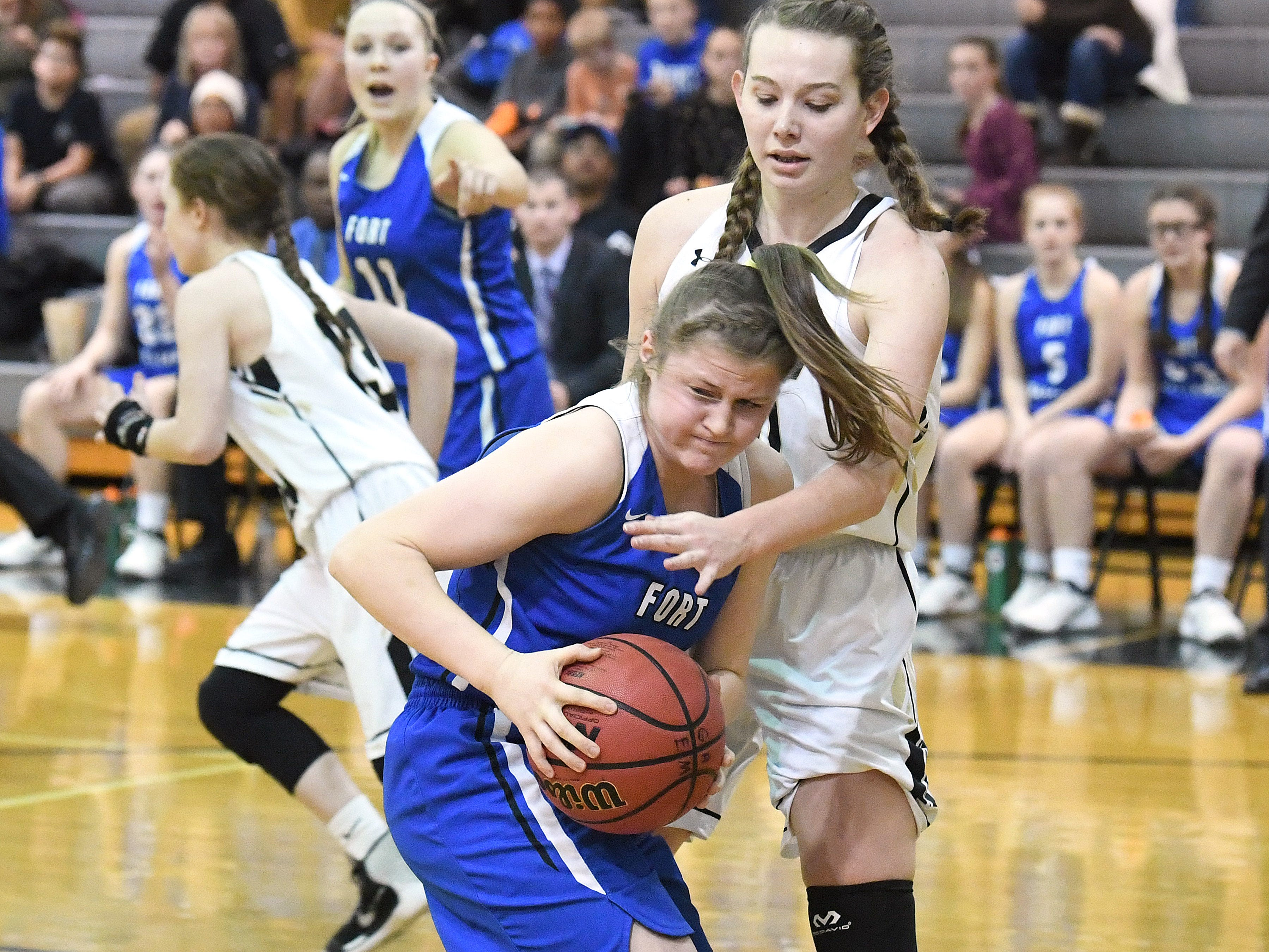 Fort Defiance's Lilian Berry comes away with the rebound, getting to it before Buffalo Gap's Sagasta Massie during a game played in Swoope on Wednesday, Dec. 5, 2018.