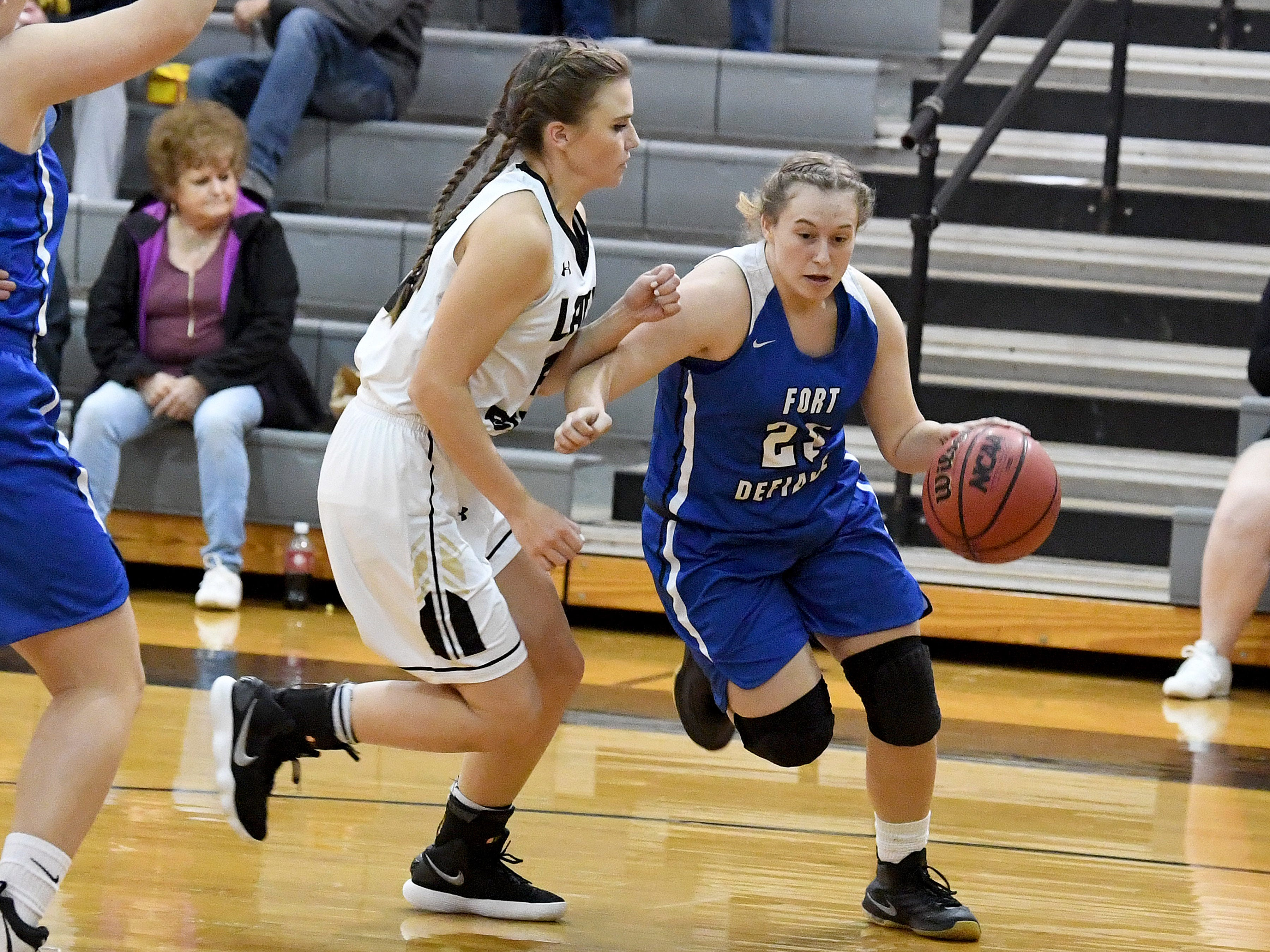 Fort Defiance's Meredith Lloyd looks to take the ball around Buffalo Gap's Sydney Digman during a game played in Swoope on Wednesday, Dec. 5, 2018.