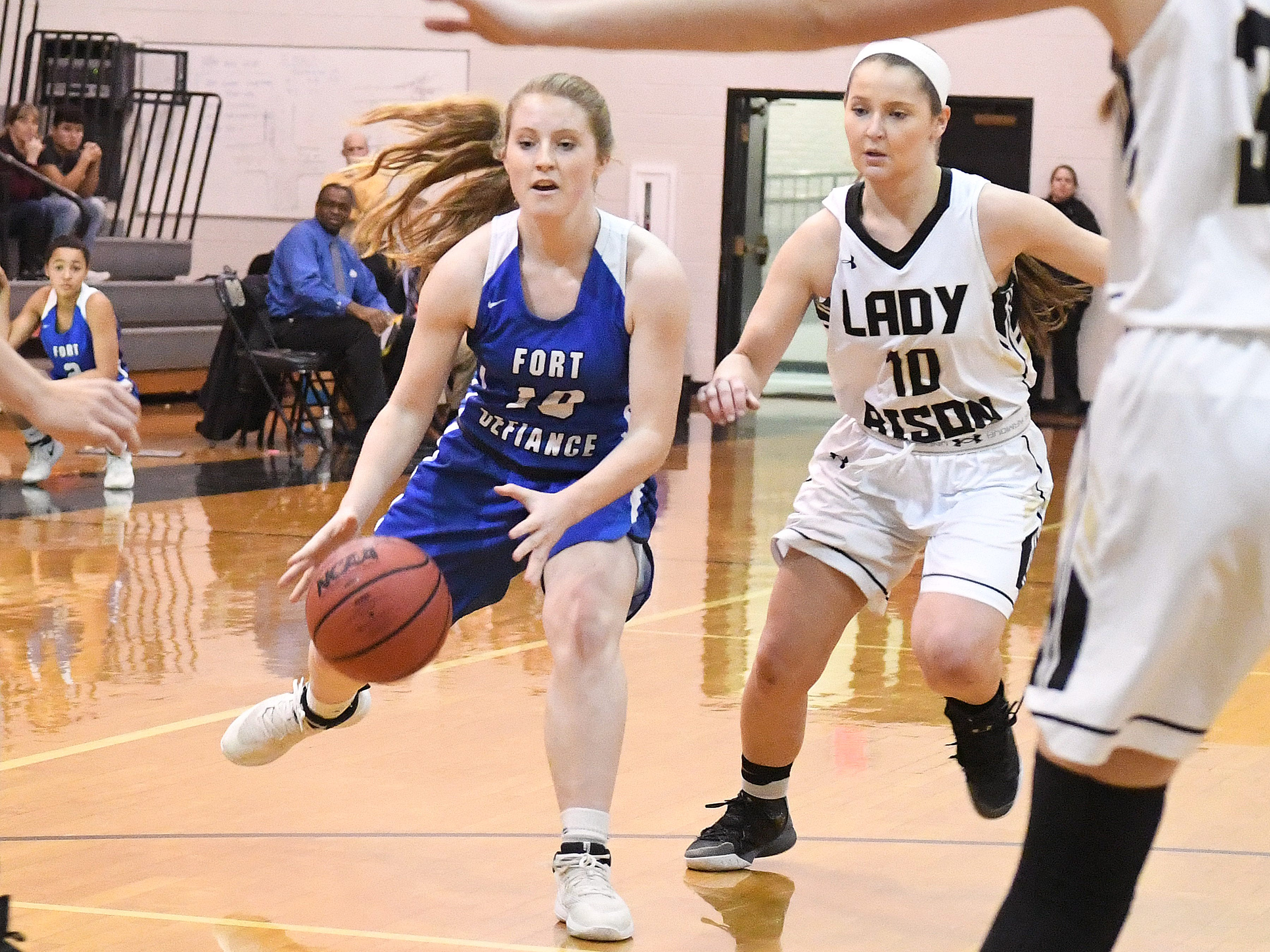 Fort Defiance's Brianna Allen has the ball as Buffalo Gap's Emily McComas guards during a game played in Swoope on Wednesday, Dec. 5, 2018.