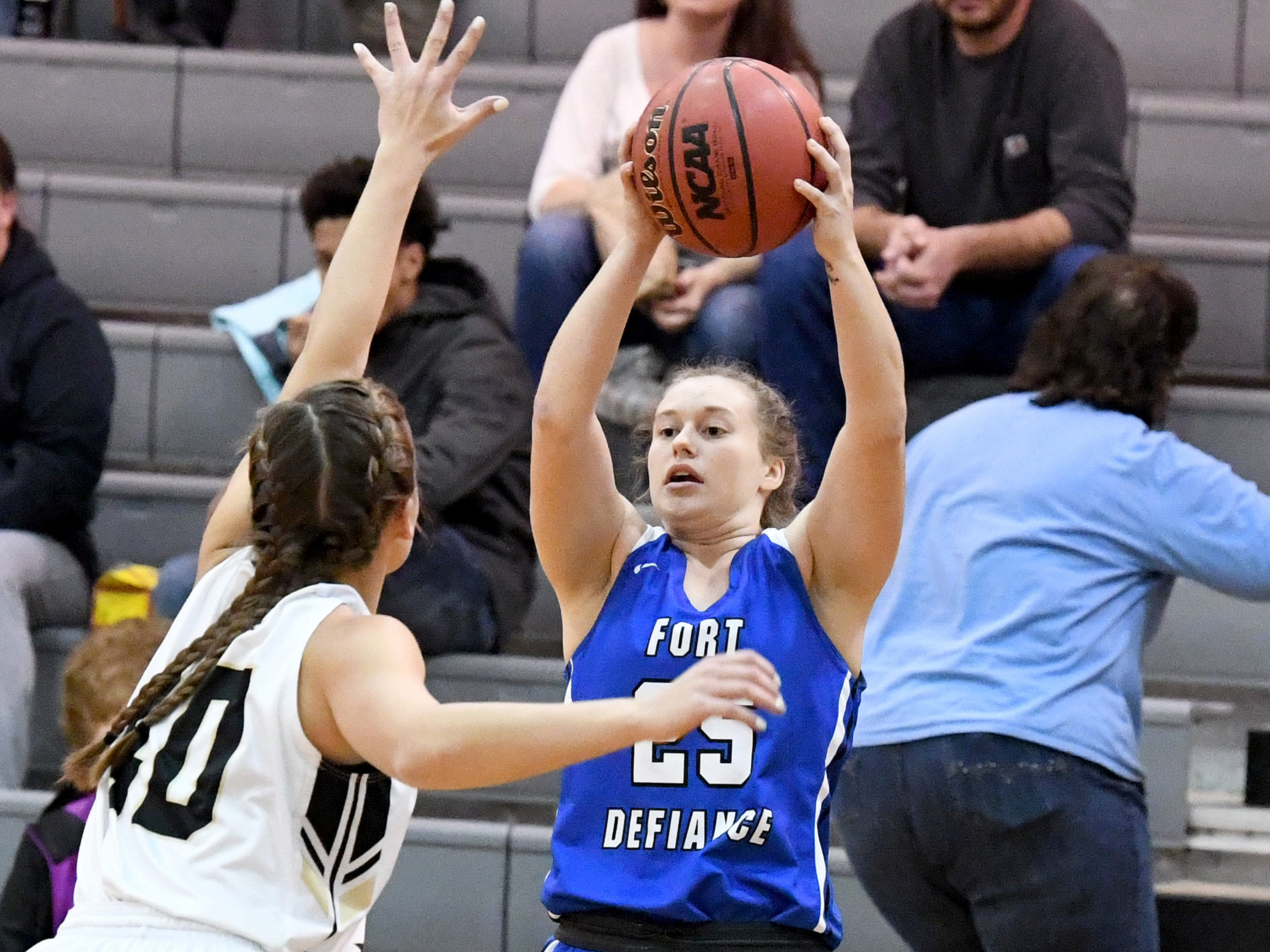 Fort Defiance's Meredith Lloyd protects the ball and looks to pass during a game played in Swoope on Wednesday, Dec. 5, 2018.