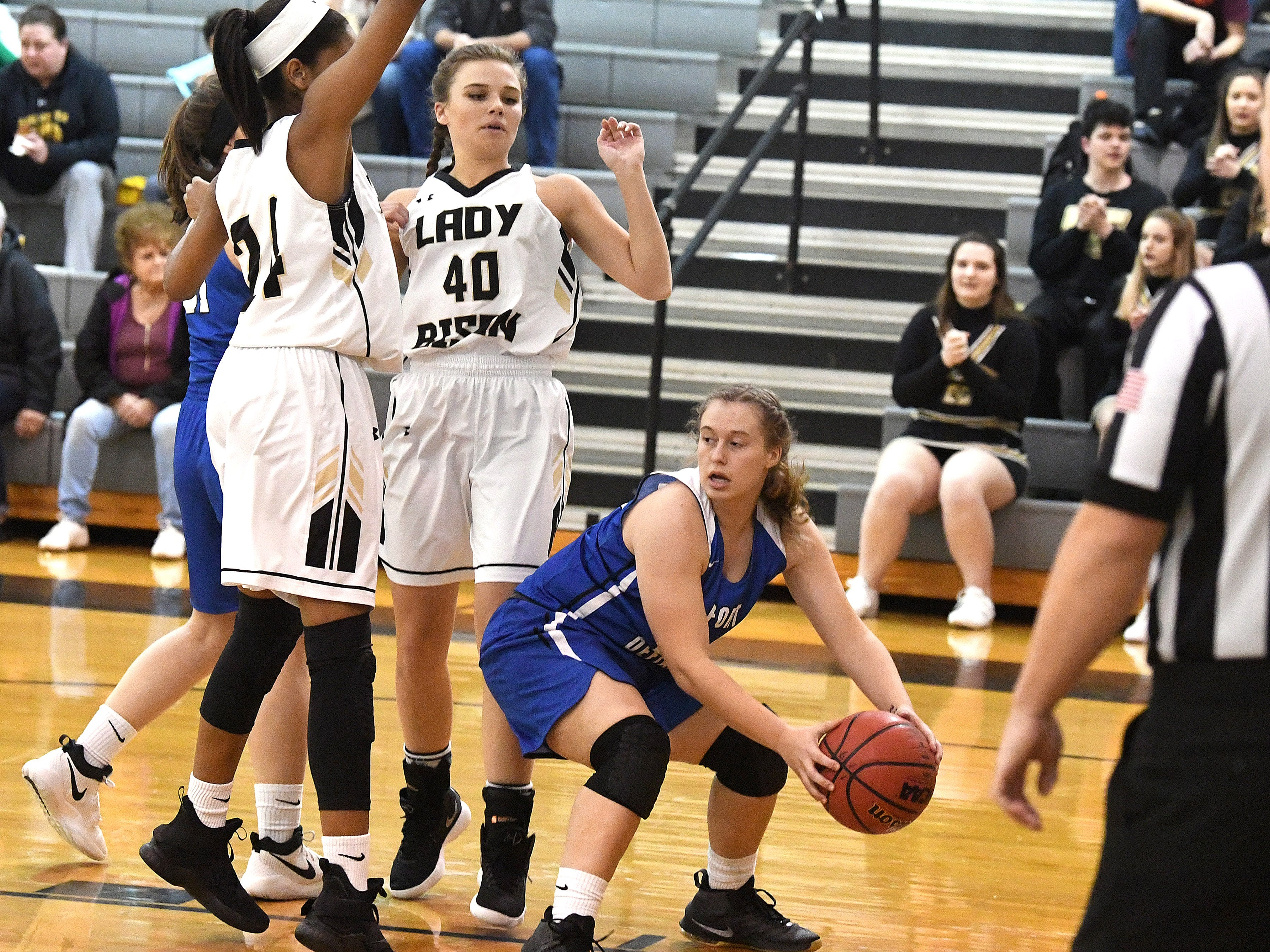 Fort Defiance's Meredith Lloyd has the ball as she is guarded by Buffalo Gap's Amaya Lucas (#24) and Sydney Digman (#40) during a game played in Swoope on Wednesday, Dec. 5, 2018.