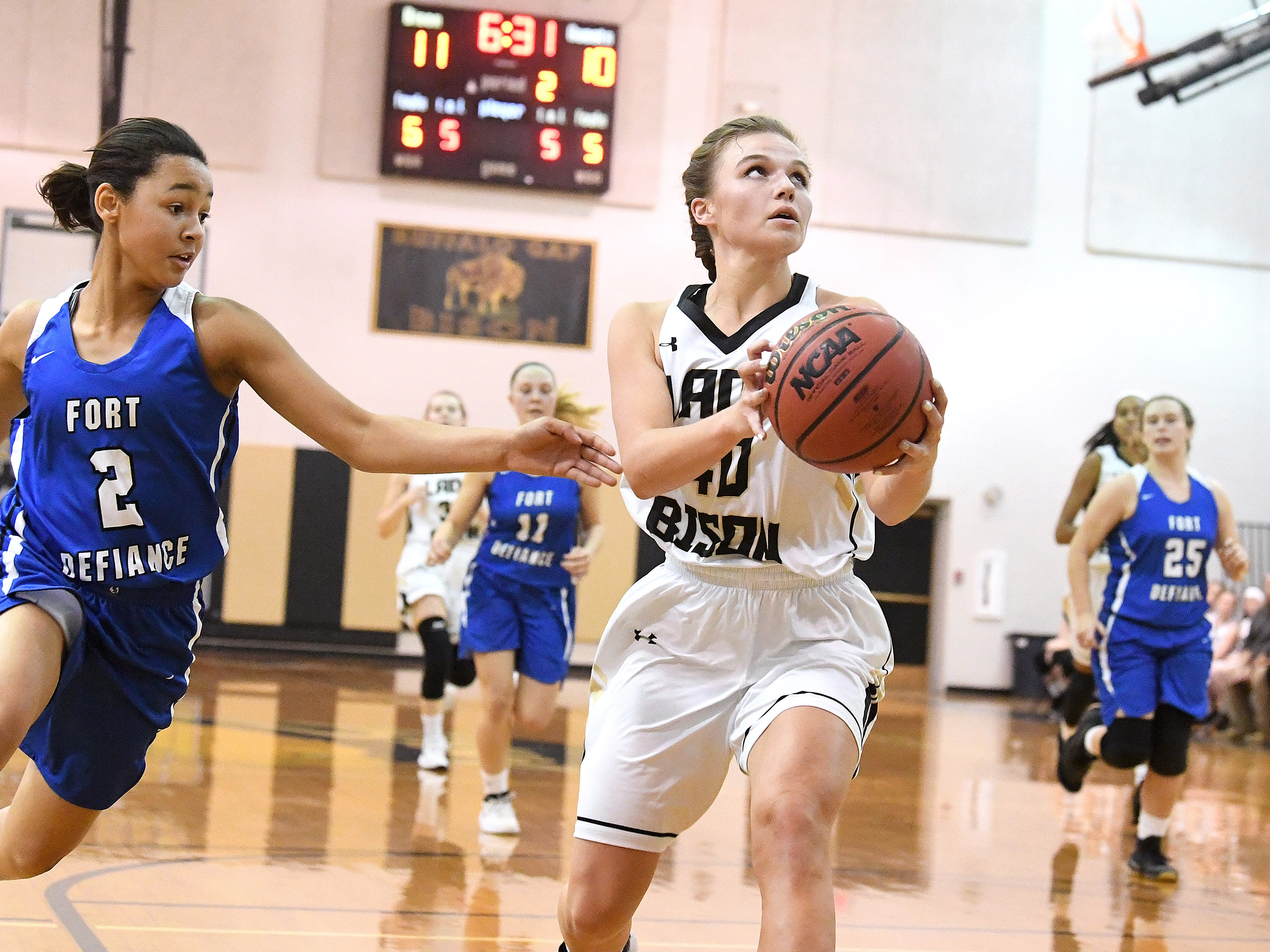 Buffalo Gap's Sydney Digman looks to the basket and prepares to shoot as Fort Defiance's Kiersten Ransome reaches towards the ball during a game played in Swoope on Wednesday, Dec. 5, 2018.