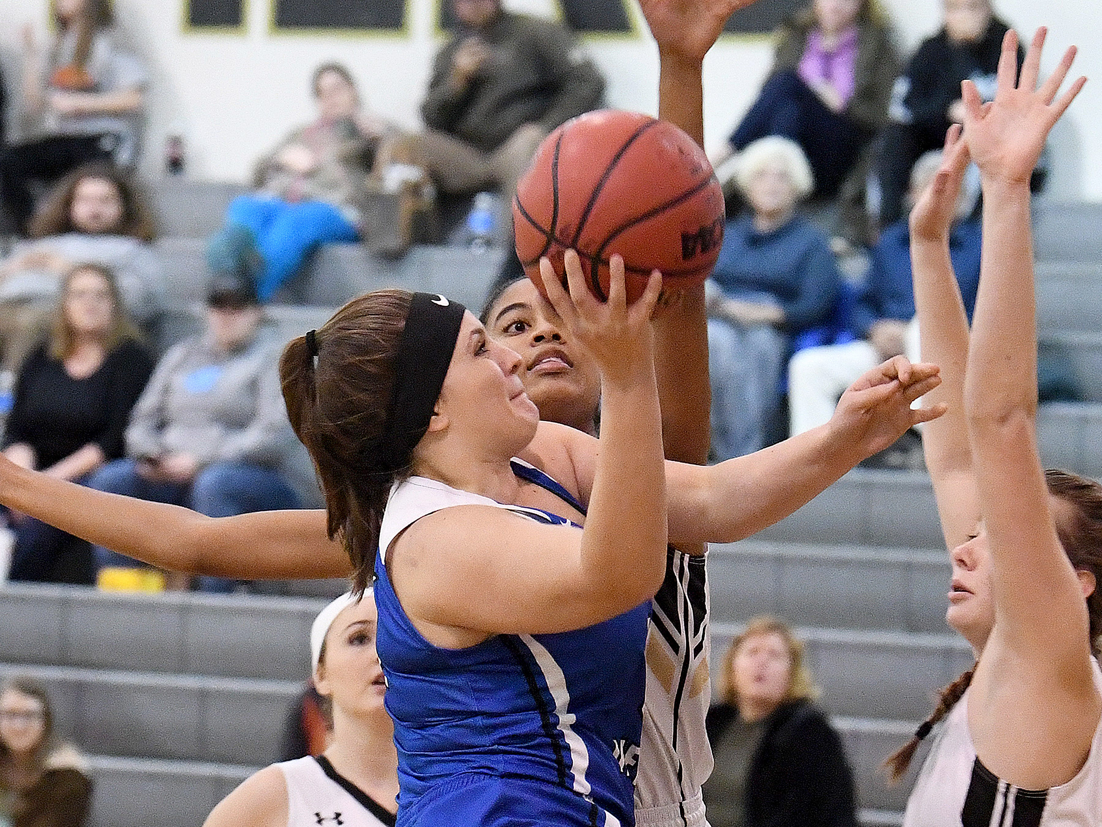Fort Defiance's Cailin Wright takes the ball up and shoots during a game played in Swoope on Wednesday, Dec. 5, 2018.