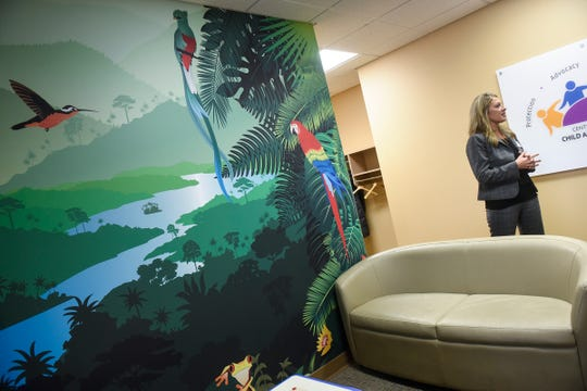 Central Minnesota Child Advocacy Center Director Katie Boecker talks about the the center's brightly decorated reception area Thursday, Dec. 6, in Sartell.