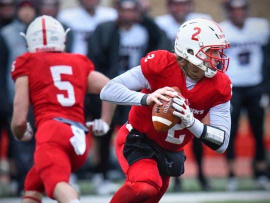 Jackson Erdmann of St. John's drops back to pass during the Saturday, Nov. 24, game against Whitworth at Clemens Stadium in Collegeville.
