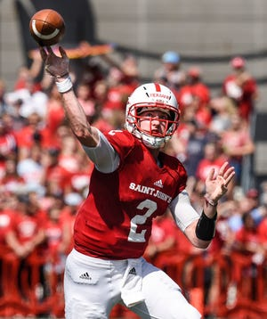 St. John's quarterback Jackson Erdmann throws a pass during the Saturday, Sept. 1, game at Clemens Stadium in Collegeville.