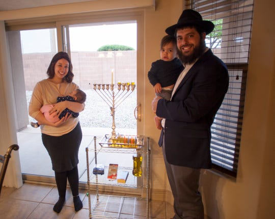 Rabbi Mendy and his family during Hanukkah Wednesday, Dec. 5, 2018.