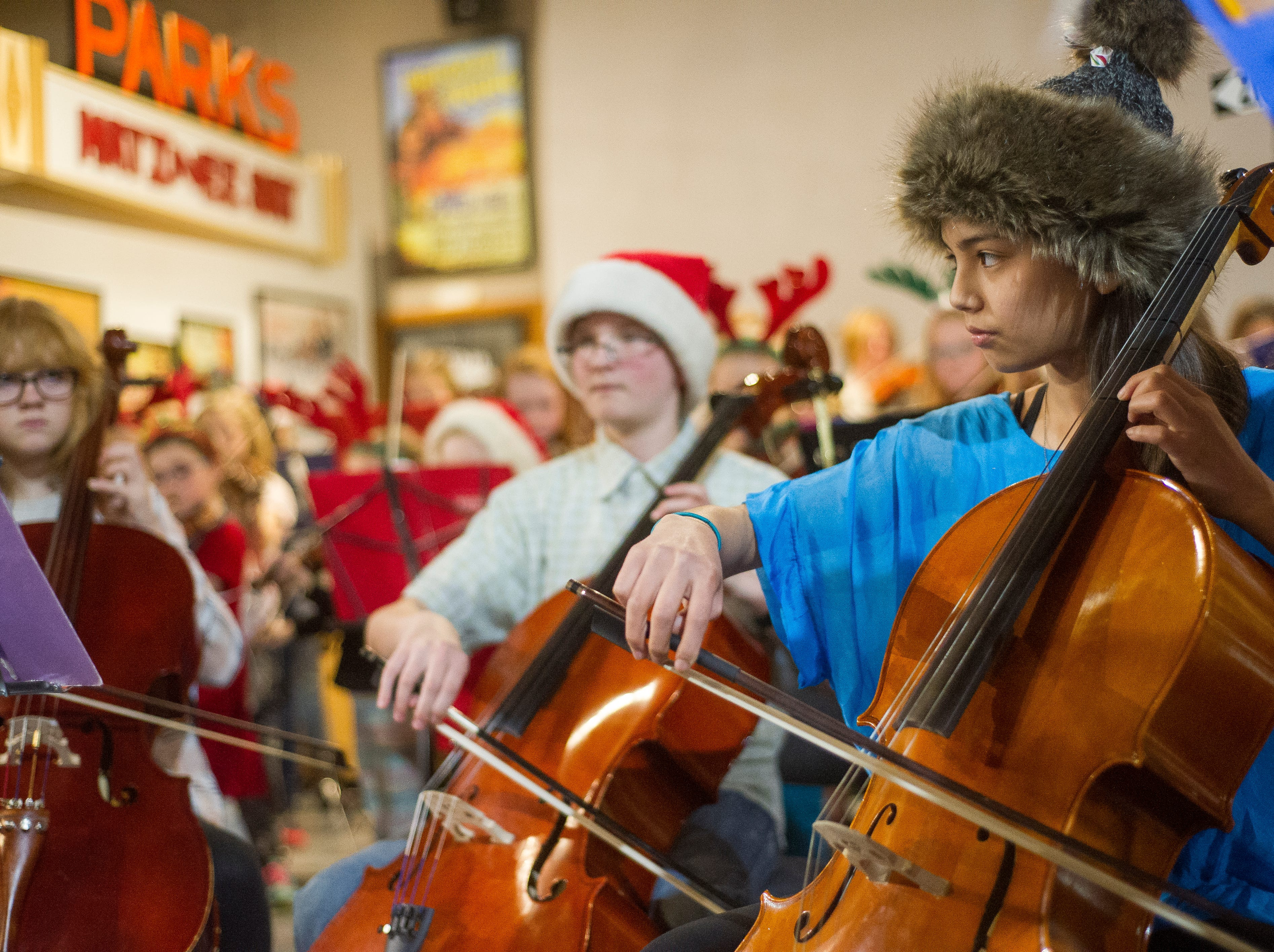 Members of the Suzuki Strings Cedar City perform holiday music during Christmas at the Homestead in Frontier Homestead State Park on Wednesday, December 5, 2018. The event included live music, crafts, and a visit with Santa Claus.