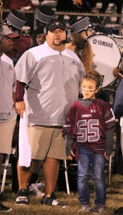 Madison County head coach Mike Coe with daughter Alexa, who is a Cowboys water girl.